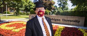 President Davies wearing a mask