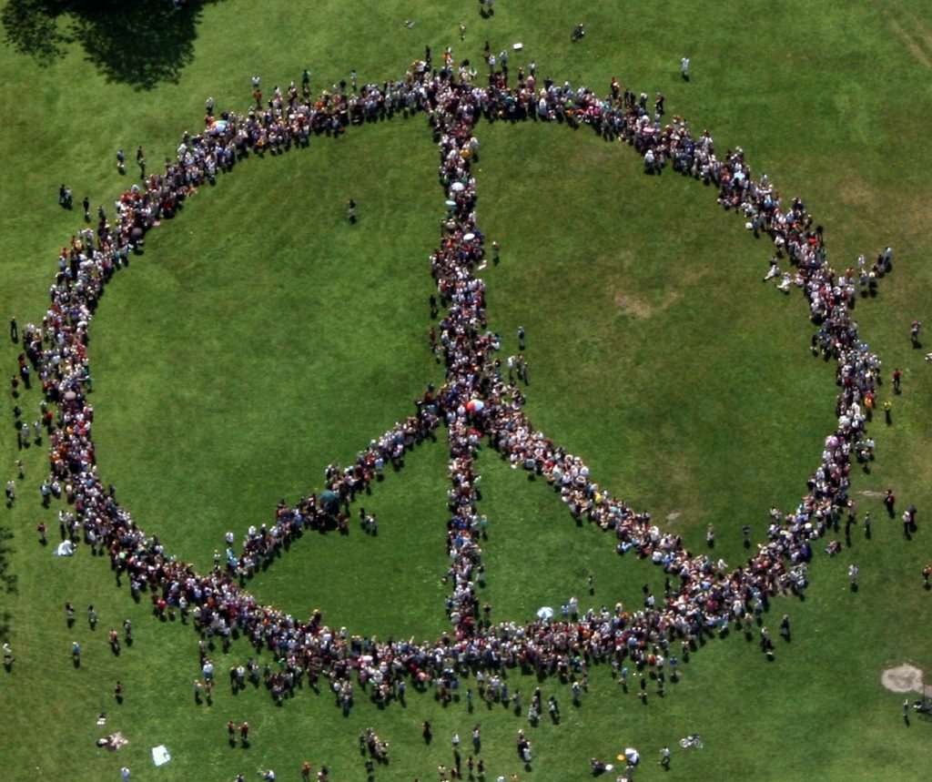 Humans forming peace sign.