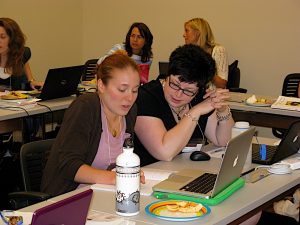 Erin Busch-Grabmeyer (right) consults with fellow teacher participant Rose Daum during the 2010 CRWP Summer Institute