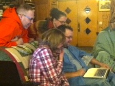 Jeremy Hyler, Penny Lew, Kathy Kurtze, and Troy Hicks work on a piece of writing at the 2013 CRWP Writing Retreat.